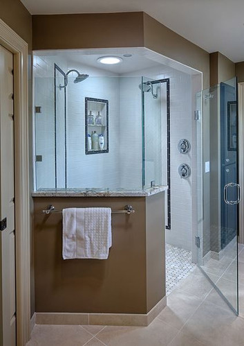 EDEN PRAIRIE OWNER'S SUITE BATH:  This beautifully designed, barrier-free shower blends classic tile with modern lines