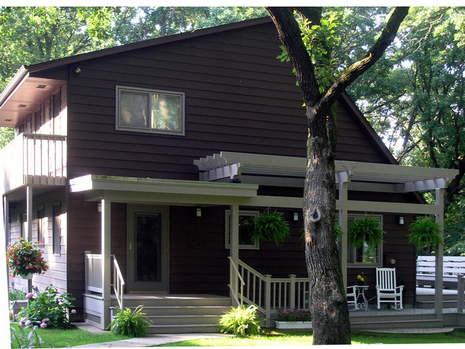 AFTER:  Plain Jane No More! We added a lovely, airy pergola and open porch to spice up the home's curb appeal