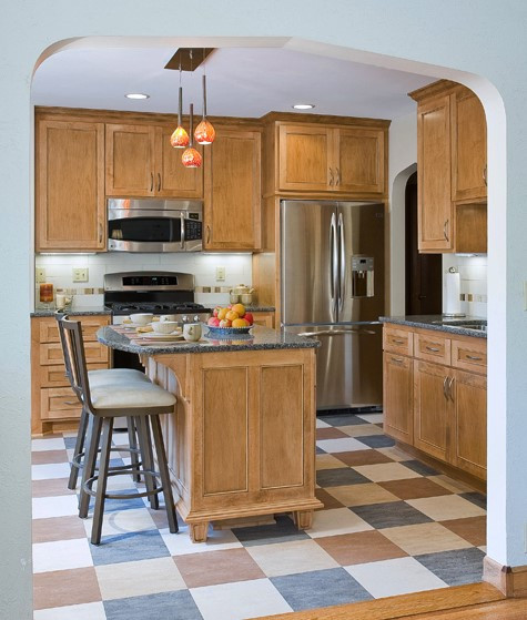 ST PAUL PERIOD KITCHEN:   A new archway between the kitchen and dining room created space for an adorable island for two