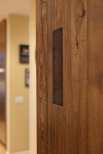 A close up of the rustic barn door