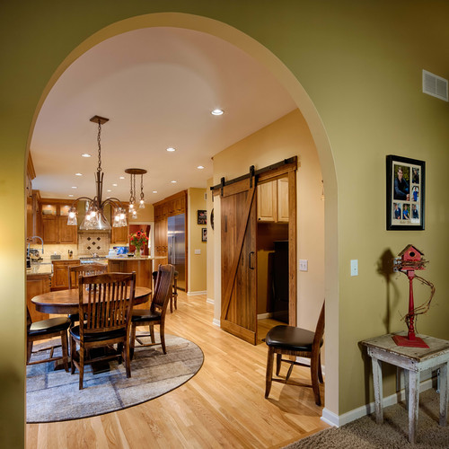 EDEN PRAIRIE TRADITIONAL KITCHEN:  We designed this grand archway to visually separate the existing family room from the dinette and kitchen space