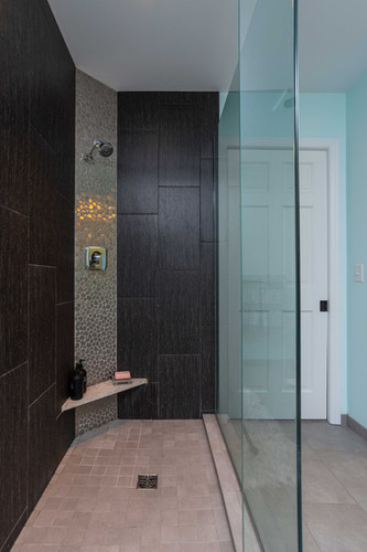 Floor to ceiling glass panels make even a small shower feel spacious