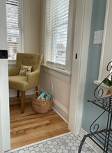 This view from the bathroom into the new entry reveals light, warmth, charm and harmony