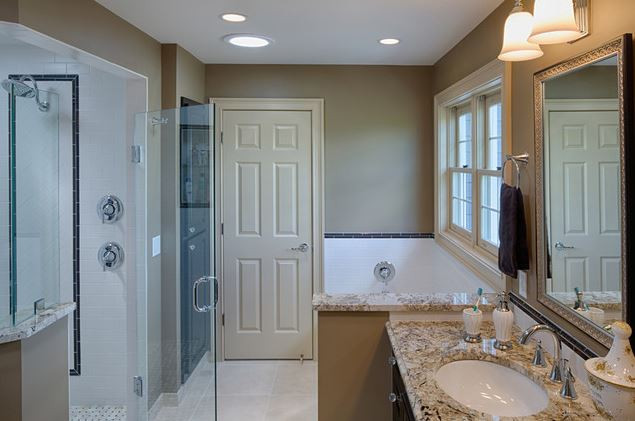 It's not easy to squeeze a double vanity, generous stand-alone shower, alcove tub and linen cabinet into a modest space, but we succeeded!