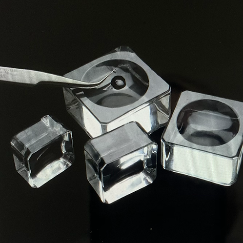 Adhesive holder in crystal