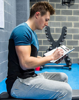 Man reading a GymPad Workout Journal