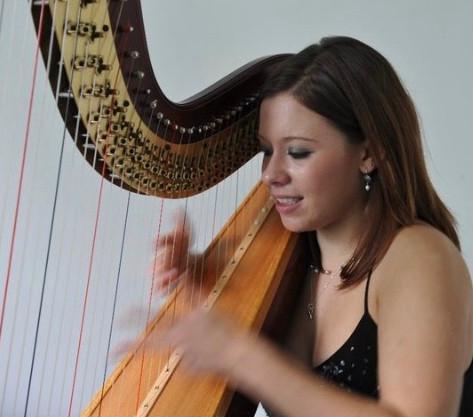 Bethan playing Harp