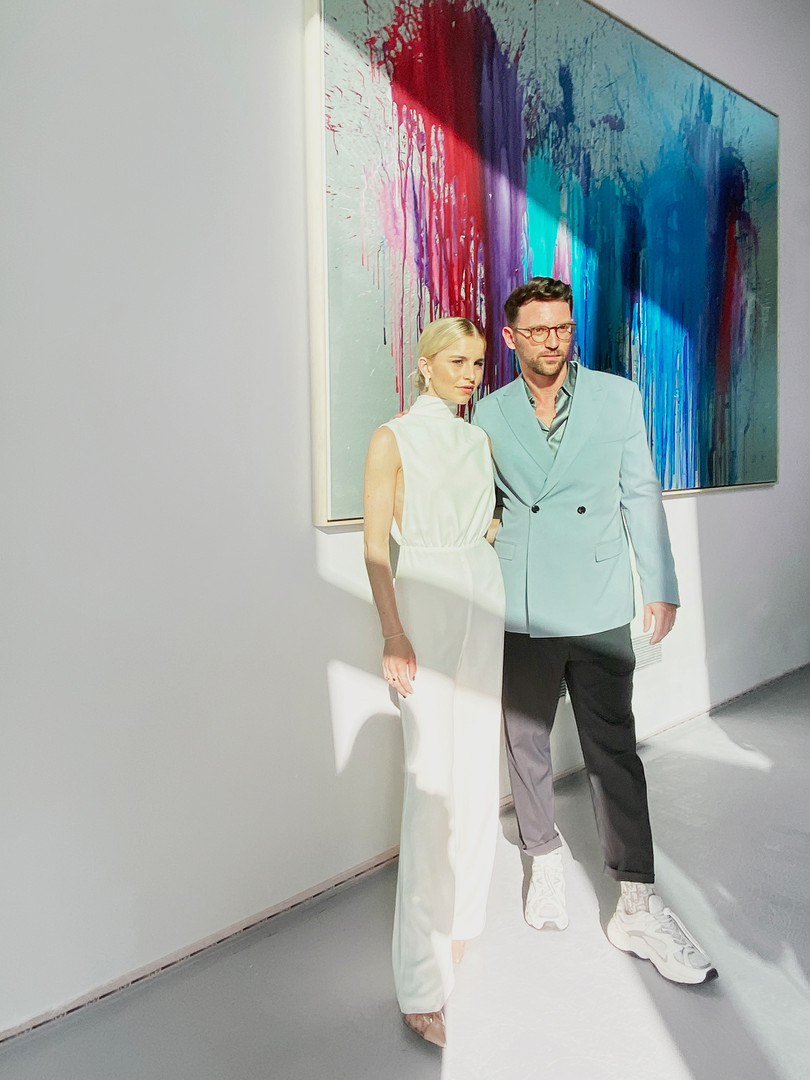 Caroline Daur and Paul Schrader posing in front of 'The Weekend'.