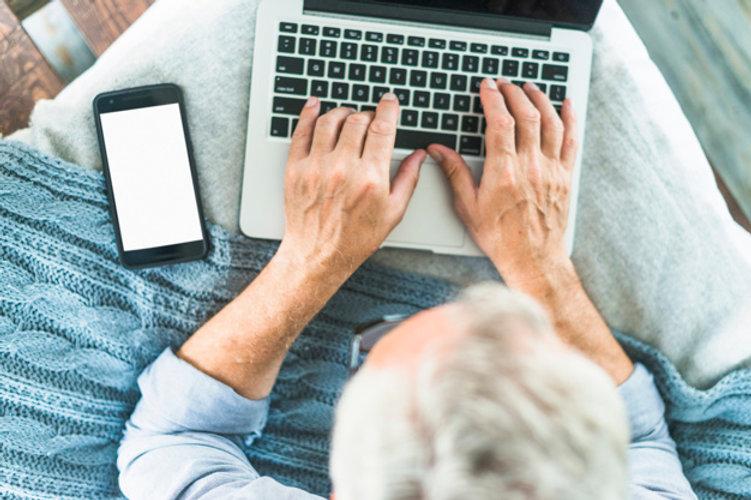 overhead-view-senior-man-s-hand-typing-l