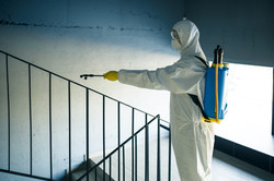 sanitizing-worker-cleaning-up-the-stairc