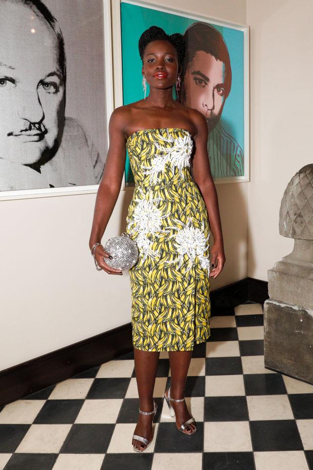 Lupita Nyong'o Mixed Banana Prints and a Disco Ball Clutch to Flawless Effect