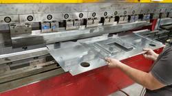 Sheet metal bending on CNC press bra