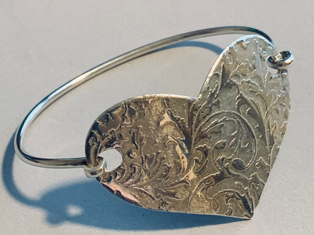 Scrolly Heart Bracelet using a background pattern pressing.