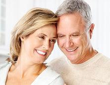 senior husband and wife smiling