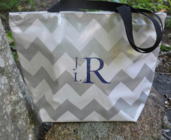 Oilcloth tote bag with monogram.