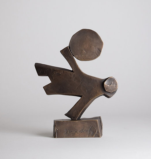 Man Holding Disk by Giles Penny