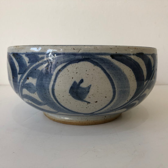 A bowl decorated with Flora by Ursula Mommens