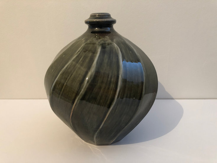 Round Faceted Cut Sided Bottle Form by Nick Rees