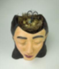 susi lopera sculpture, ceramic face, susi lopera art, susi lopera, surrealist art, ceramic sculpture, figurative ceramic art, bust ceramic, self portrait clay, portrait clay, clay bust, bird's nest art, clay face, bird eggs art,