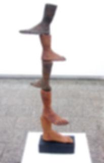 susi lopera sculpture, ceramic face, susi lopera art, susi lopera, surrealist art, ceramic sculpture, foot art, feet art, feet sculpture, clay tower art, stacking clay sculpture, foot sculpture, human history art, ancestors art, weird ceramic art, weird clay art, weird foot art