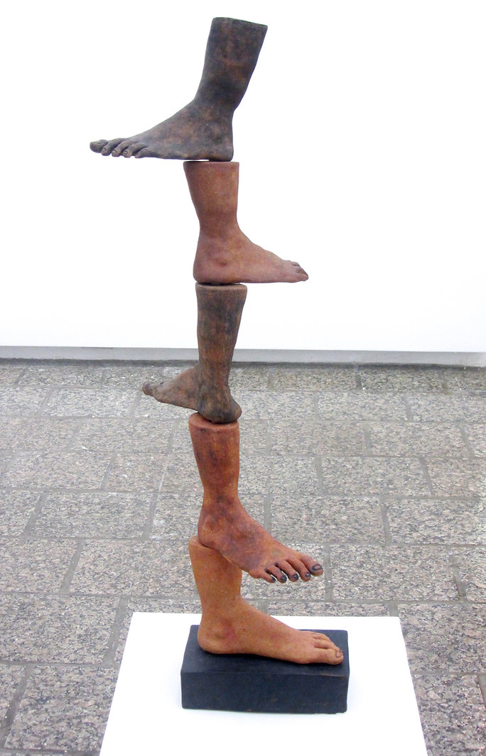 susi lopera sculpture, ceramic face, susi lopera art, susi lopera, surrealist art, ceramic sculpture, foot art, feet art, feet sculpture, clay tower art, stacking clay sculpture, foot sculpture, human history art, ancestors art, weird ceramic art, weird clay art, weird foot art