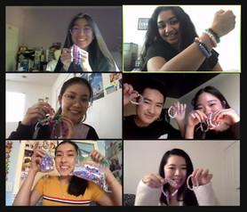 A few of our Actives making bracelets together on Zoom for Laura's House