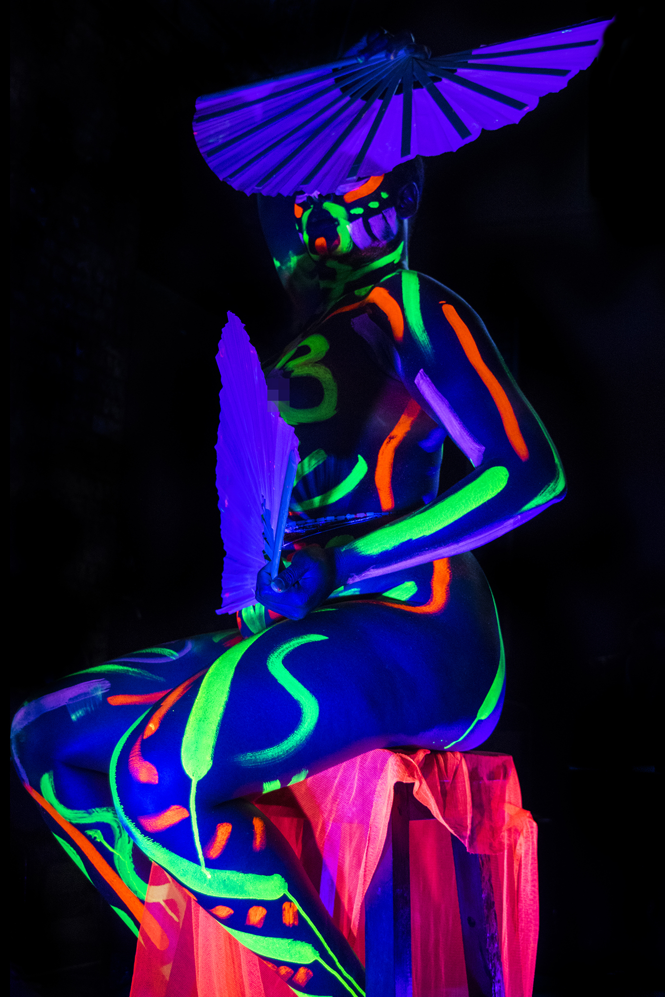 Erykah modelling for Neon Naked.