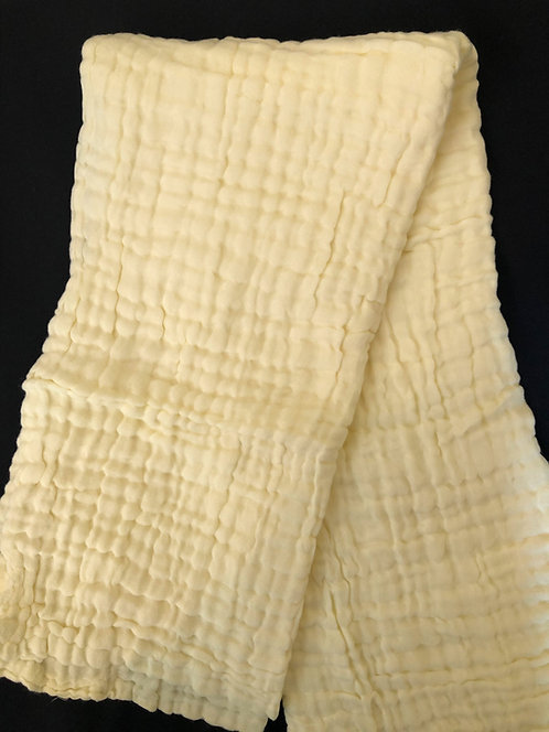 yellow muslin blanket