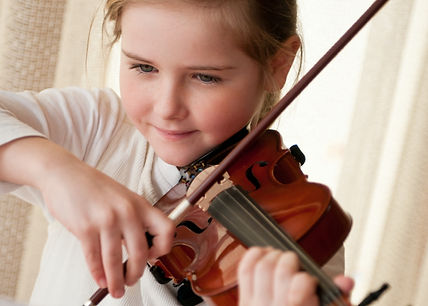 Cute child (little girl) playing violin