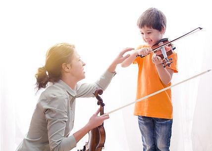 MOther or teacher teaching little boy pl