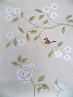 A fanciful bird and tree design