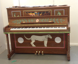 dog under a piano