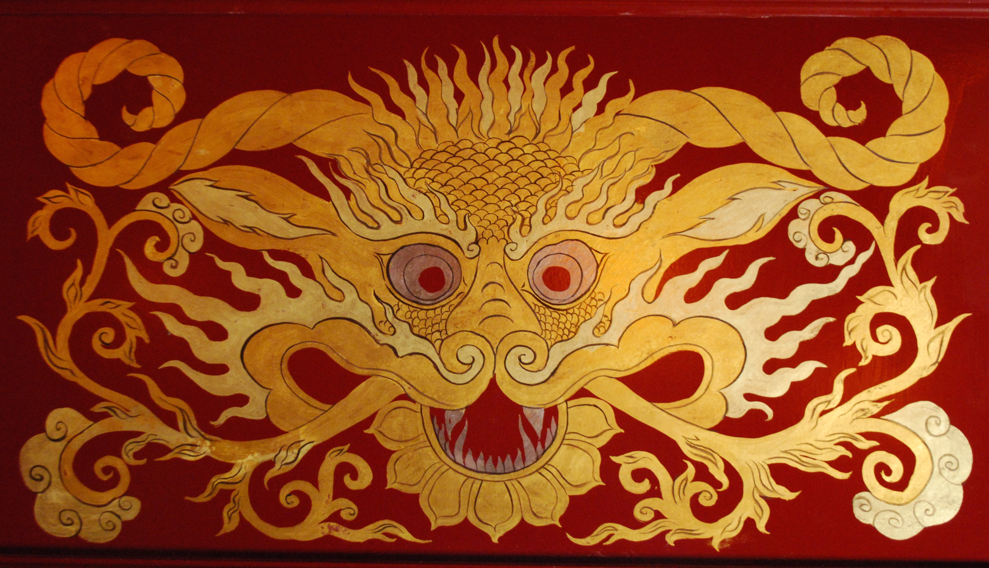dragon head, gold on red lacquer