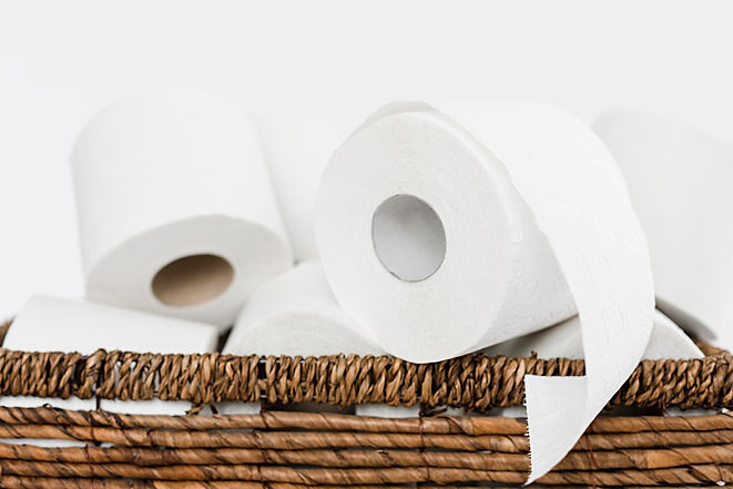 close-up-backet-with-toilet-paper-rolls.