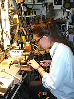 Student creating her own piece of jewelry under the instruction of Vladimir Deming