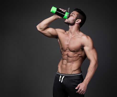 Muscular man with protein drink in shake