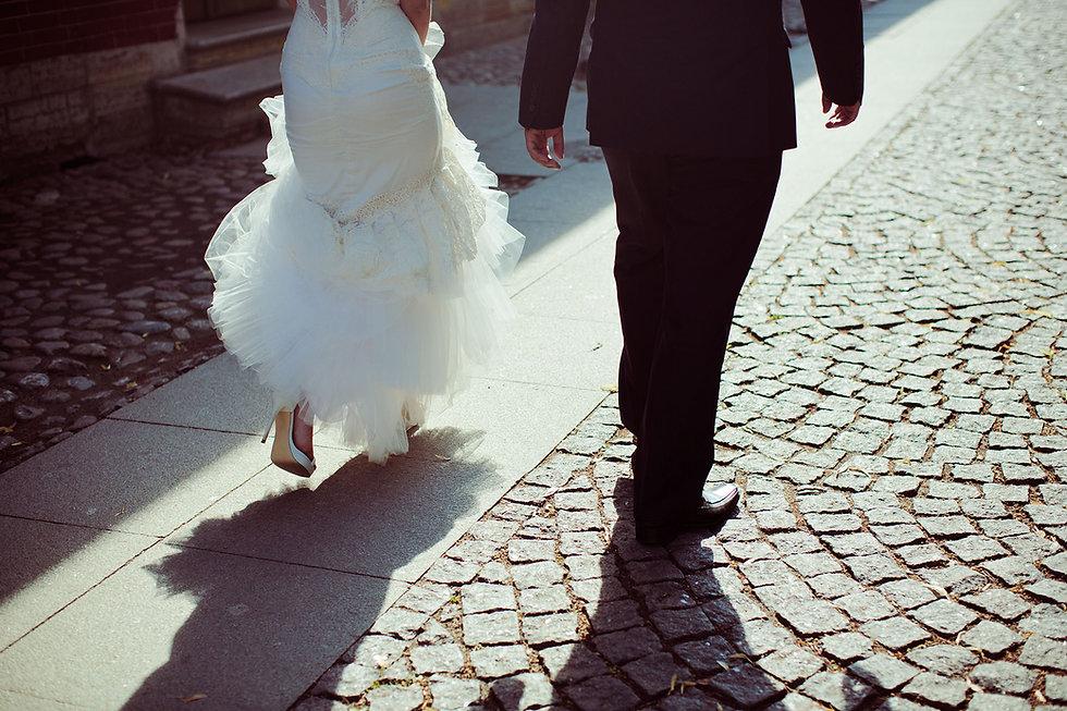 Bride and Groom Walking Away