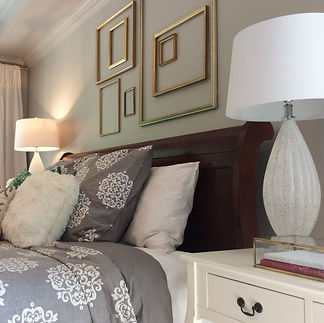 Puddy grey and gleaming gold set this master bedroom apart from others.  #goldframes #greybedding #gold accents #white curtains #bedroommakeover