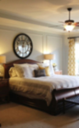 Picture molding, beachy bedding and a yellow a grey pallette complete this master bedroom makeover. #masterbedroom #makeove #decor #largeclock #grey #yellow #picturemolding #decor #design