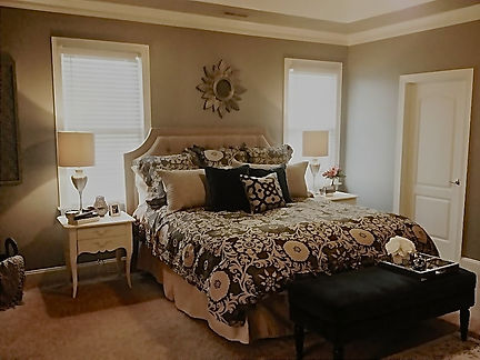 Romantic travel pictures and global decor make a beautiful bedroom makeover.  #sunburstmirror #photocollage #upholsteredheadboard #floorplan #decor
