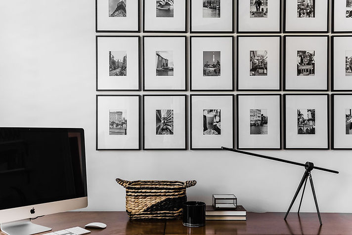 A black and white fusion of pictures and decor create a striking edge and global feel to this modern home office