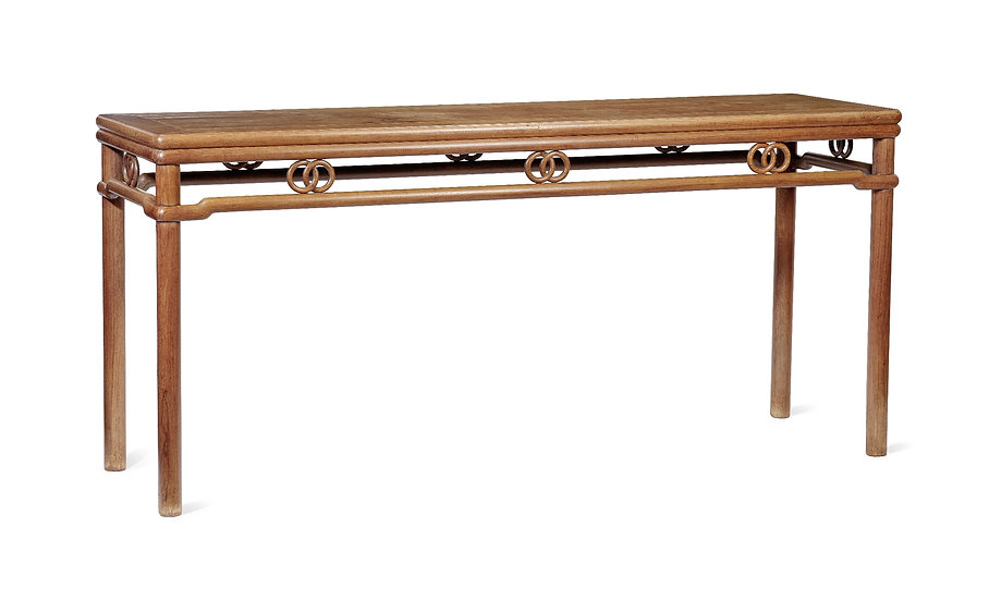 Huanghuali table in the round-leg wrap-around stretchers style