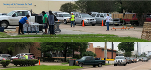Long lines of vehicles at the Society of St. Vincent de Paul.