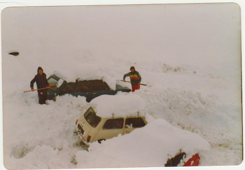 Digging out the cars after a big dump of snow