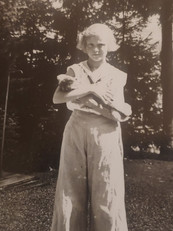 Charlotte as young girl holding kitten.