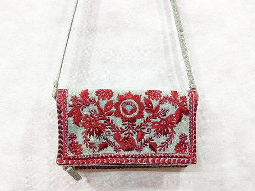 306/1 - Embroidered sling bag