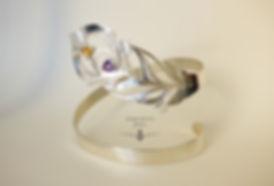 Bracelet plume logo petit.jpg