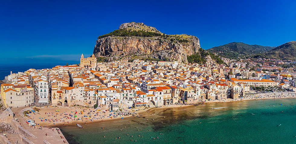 1280px-View_of_Cefalu_from_above_(449459