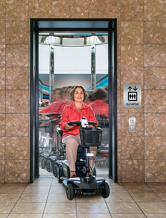 2021 - scooter Woman leaving elevator (1