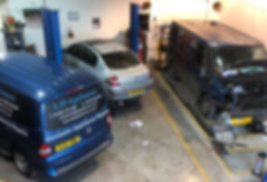Light commercial vehicles being repaired